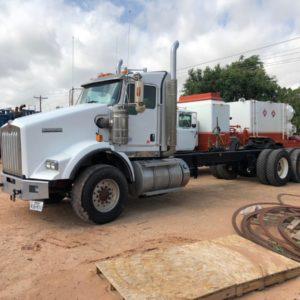 Winch Trucks on a site in Midland, TX